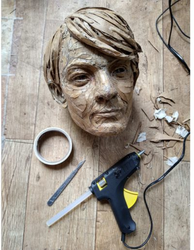 effects of lockdown - the head of the sculpture and some of the tools used to create it